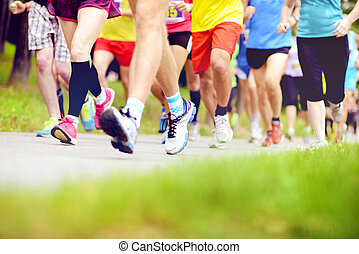 Unidentified marathon racers running - Group of unidentified...