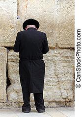 Unidentified orthodox jewish man praying at the Wailing wall (Western wall)