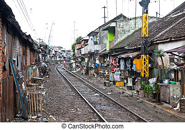 MALANG, JAVA, INDONESIA- JANUARY 8: Unidentified poor people living in slum at January 8, 2012 in Malang on Java, Indonesia. According to 2010 Indonesia reduced their slum populations by more than 40%..