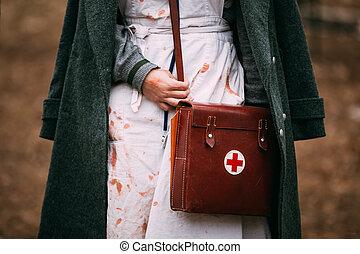 Unidentified re-enactor wears historical German Red Cross -...