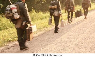 Unidentified Re-enactors Dressed As German Wehrmacht Soldier...