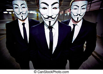 Close-up portrait of a group of people of the uniform appearance wearing Guy Fawkes masks