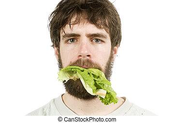 Unimpressed with Salad - A young male with lettuce in his...