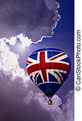 Union Jack balloon in a blue sky - Colouful red white and ...