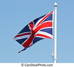 Union Jack Flag on flagpole - The red, white and blue Union...