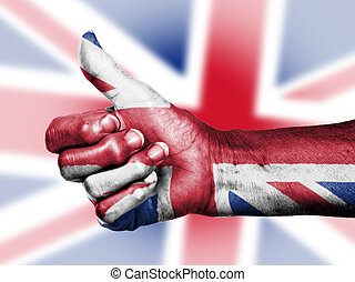 Union Jack on thumbs up hand isolated on a flag background