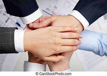 Union - Image of business partners hands on top of each...