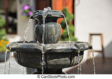 Unique fountain erupting some water at day - Unique fountain...