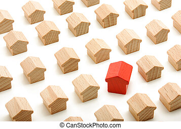 Unique house in group of wooden houses on white background
