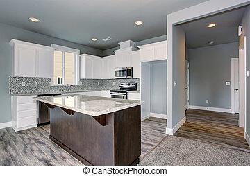 Unique kitchen with gray hardwood floor.