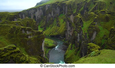 Unique landscape of Fjadrargljufur in Iceland. Top tourism destination. Fjadrargljufur Canyon is a massive canyon about 100 meters deep and about 2 kilometers long, located in South East of Iceland.