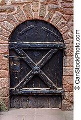 Unique old wooden door in exterior wall