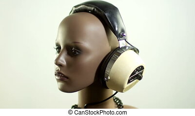 unique stop motion clip a fashion mannequin head wearing retro headphones