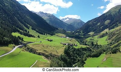 Scenic summer mountain landscape of Swiss Alps with green hillsides, valleys and highland pastures, canton of Grisons