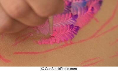 Unique technique of painting - Vivid colors on a human body....