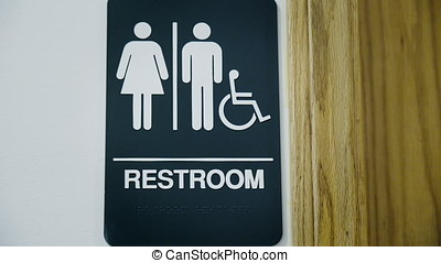 Unisex Public Restroom Sign - Tilt up shot from door handle...