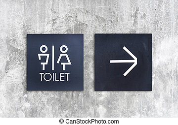 Unisex restroom or Tolet and arrow sign on concrete wall style boutique
