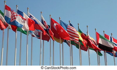 United Flags - Rows of flags blowing in the wind against ...