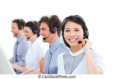 United group of customer service agents working in a call center against a white background