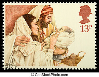 UNITED KINGDOM - CIRCA 1984: A British Used Christmas Postage Stamp showing Mary, Joseph and Baby Jesus, circa 1984