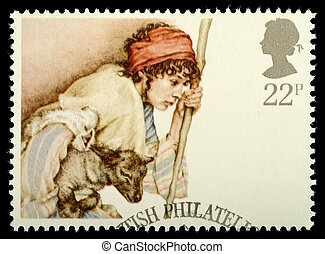 UNITED KINGDOM - CIRCA 1984: A British Used Christmas Postage Stamp showing Shepherd and Lamb, circa 1984