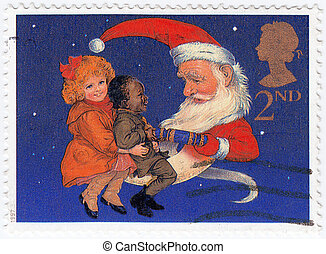 UNITED KINGDOM - CIRCA 1997: stamp printed in UK Christmas Postage Stamp showing Children and Santa pulling a Christmas Cracker, circa 1997
