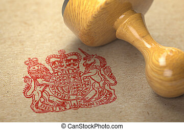 United Kingdom coat of arms stamp with rubber stamp on craft paper.
