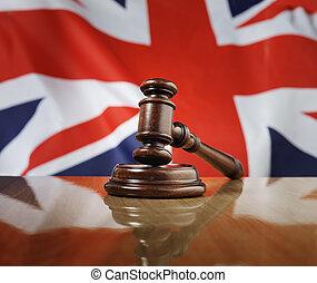 United Kingdom Law - Mahogany wooden gavel on glossy wooden...