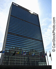 United Nations building in New york City with many flags