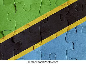 Illustration of a flag of United Republic of Tanzania over some puzzle pieces. Its a JPG image.