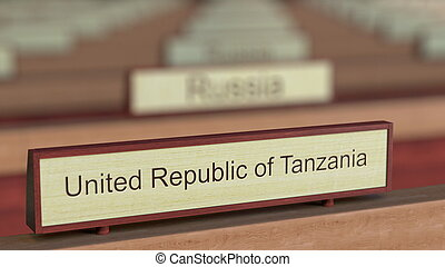 United Republic of Tanzania name sign among different countries plaques at international organization. 3D