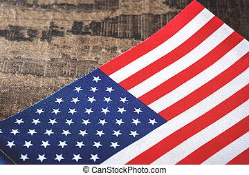 United States flag on a rustic wood