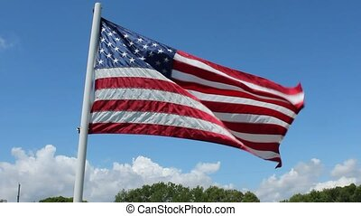 united states flag - the United States flag waving against a...