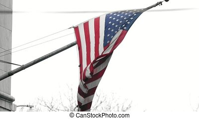 United States flag waving in the wind, telephoto