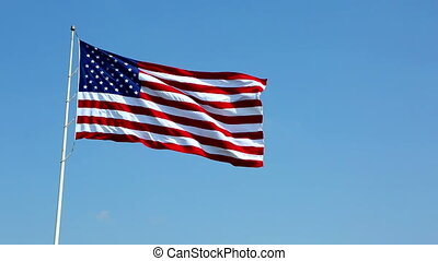 United States Flag Waving - United States flag on a pole...