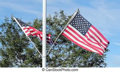 United States flags - Two United States flags blowing in the...