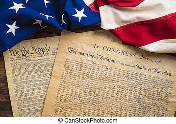 United States founding documents on a vintage American flag...