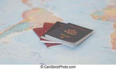 FHD Forward View of United States of America and Sweden Passports on a Blurry and Colorful World Map