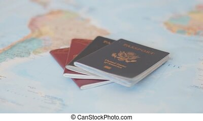 FHD Video of United States of America and Sweden Passports Next to South America on a Blurry and Colorful World Map