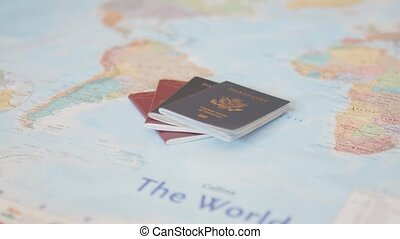 FHD Video of United States of America and Sweden Passports on a Blurry and Colorful World Map
