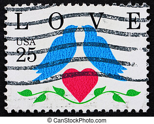 UNITED STATES OF AMERICA - CIRCA 1990: a stamp printed in the United States of America shows two birds with heart and word love, circa 1990