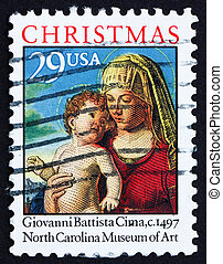 UNITED STATES OF AMERICA - CIRCA 1993: a stamp printed in the USA shows Madonna and Child in a Landscape by Giovanni Battista Cima, Christmas, circa 1993
