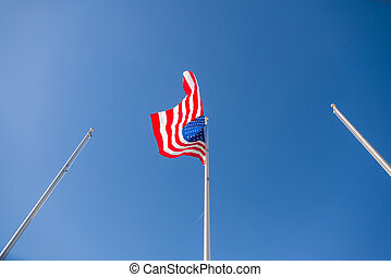 United States of America Flag on column with blue sky