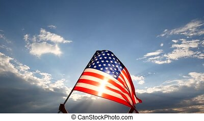 United States of America Flag. The red white and blue. U.S,A, Stars Stripes, flying with blue sky.