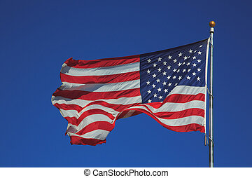 United States of America flag waving in blue sky