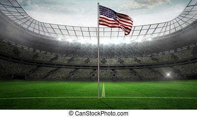 United States of America national flag waving on flagpole in...