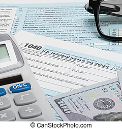 United States of America Tax Form 1040 with calculator, dollars and glasses - 1 to 1 ratio