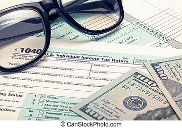 United States of America Tax Form 1040 with dollars and glasses