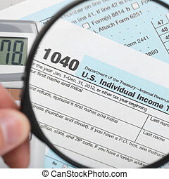 United States of America Tax Form 1040 with magnifying glass - 1 to 1 ratio