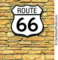 United States historic Route 66 road sign on a blank brick wall. American highway from Chicago city of Illinois to Santa Monica town in California.